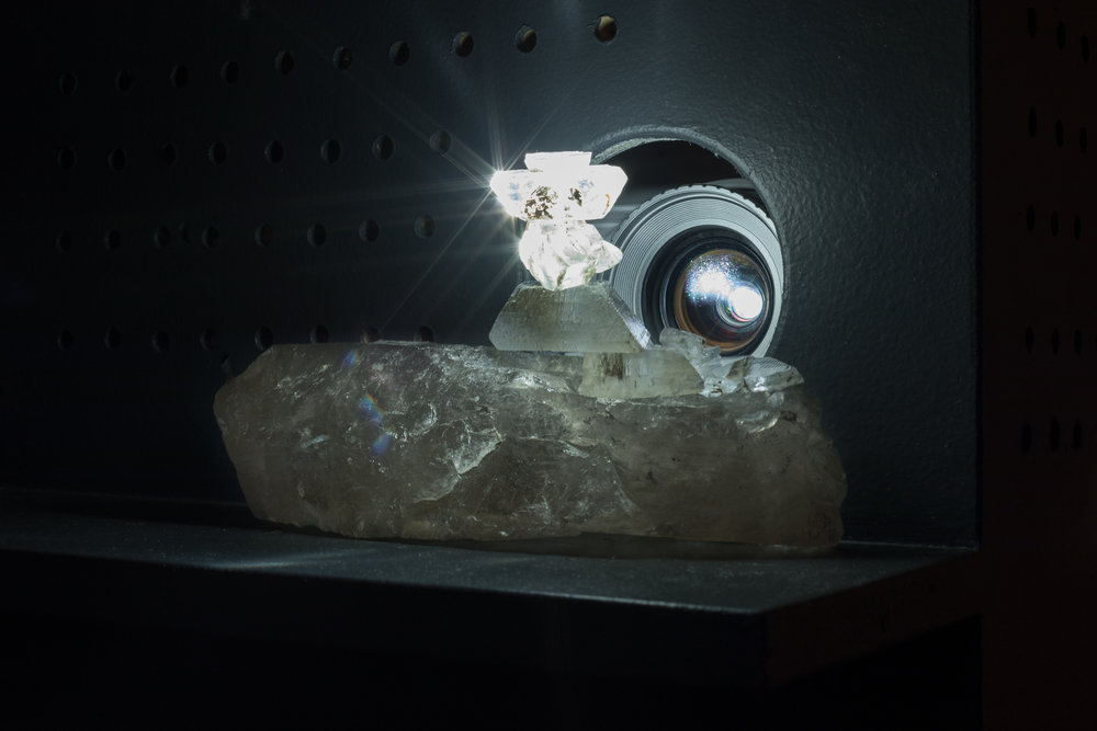 Tania Willard,  Only Available Light , from the series  Only Available Light , 2016. Archival film (Harlan I. Smith,  The Shuswap Indians of British Columbia , 1928), projector, selenite crystals and photons. Film 8:44. Original composition by Leela Gilday. Photo:Toni Hafkenscheid.
