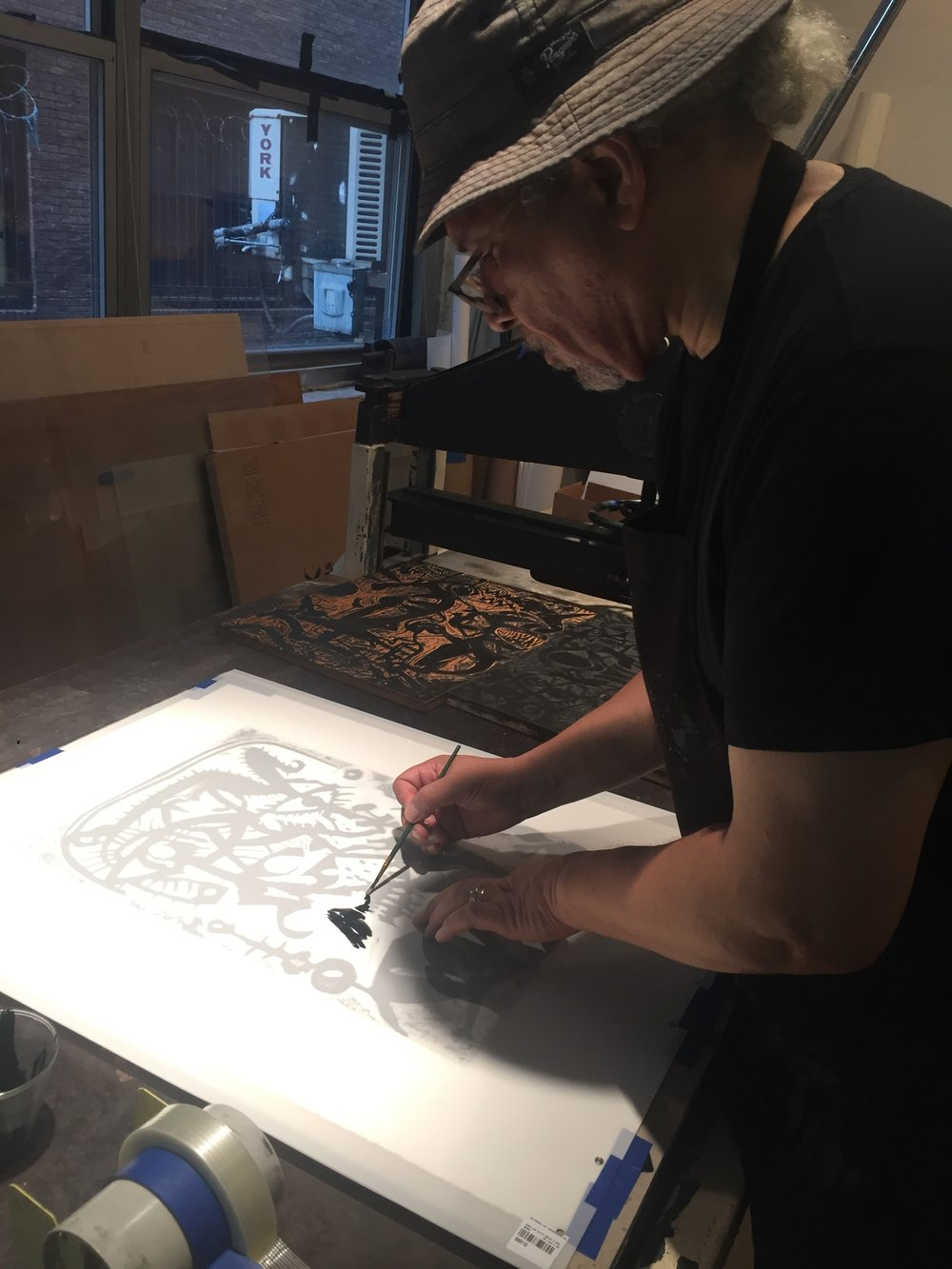 Michael Kelly Williams working on lithograph  Tenacity