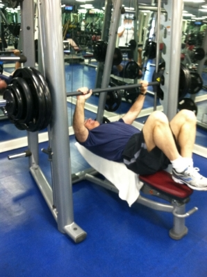 A quick shot of me ready for a serious rep @300. Notice the feet up on the bench for back support. Wise lifting.