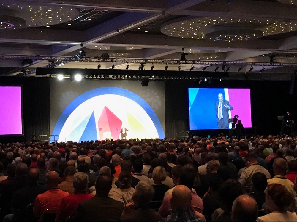 Tom speaks on True Success to 4,500 people in the Denver Convention Center, June 2017. A great fun hour of wisdom, laughter, and energy ending with a long standing ovation for philosophy!