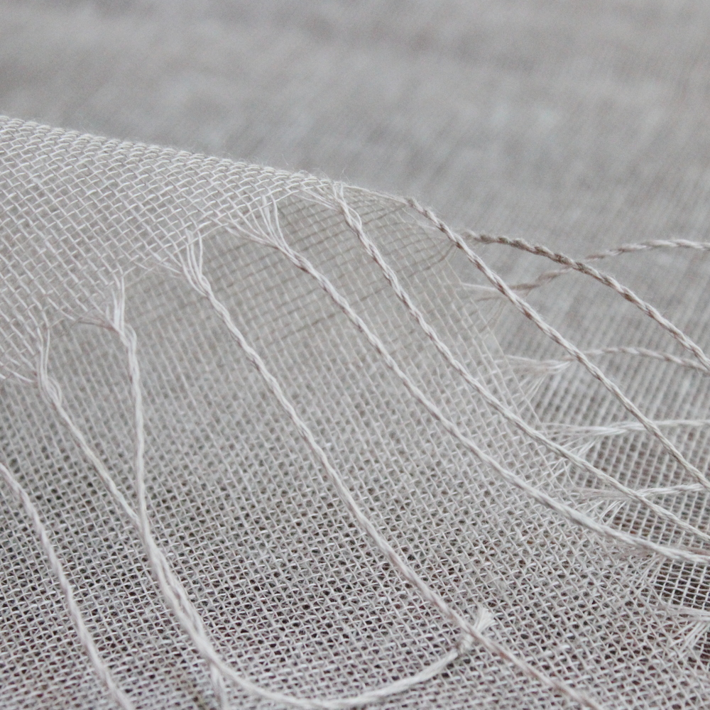 Fine - woven linen shawls.