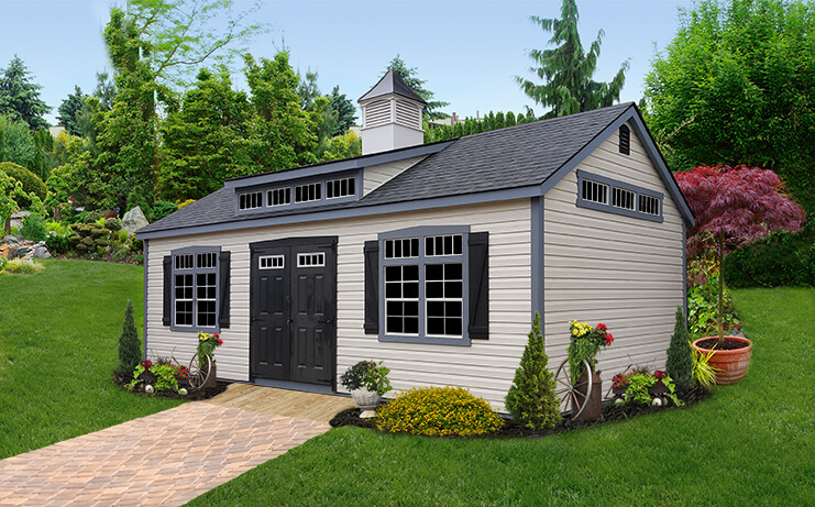 Premier with vinyl siding. Shown with optional cupola, premier transom dormer package, transom glass on gable ends, and painted doors.