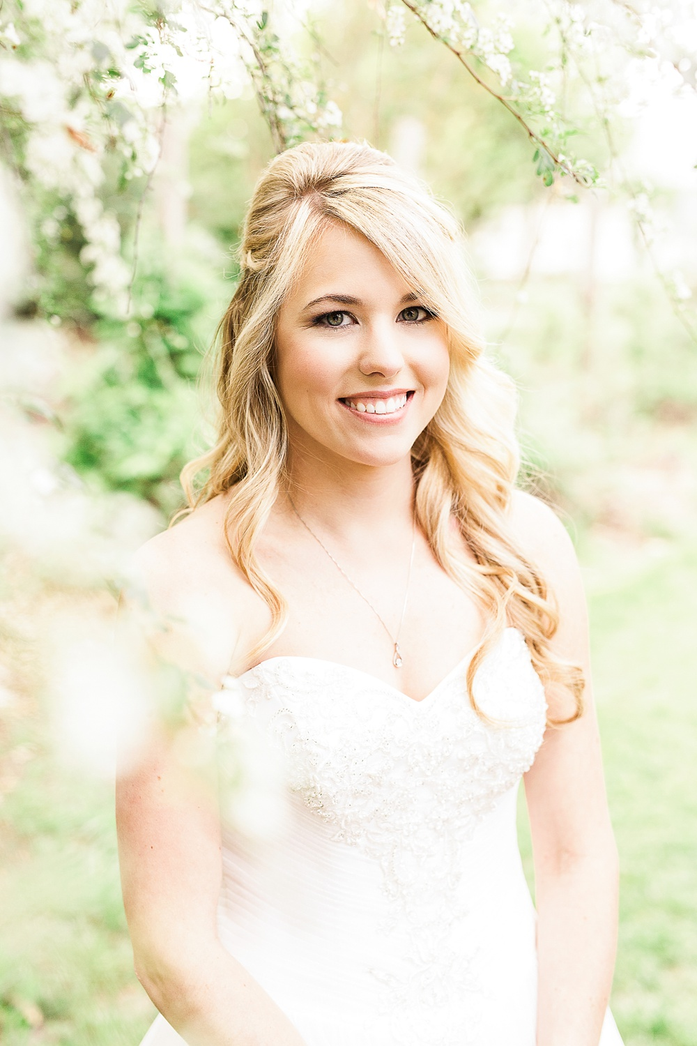 bridal portrait in the white spring blooms