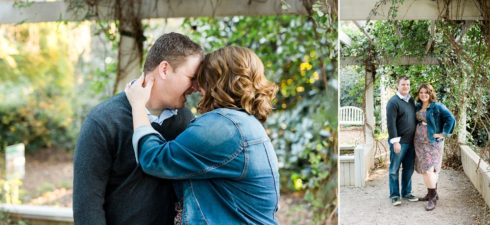 engaged couple under an arbor with green vines