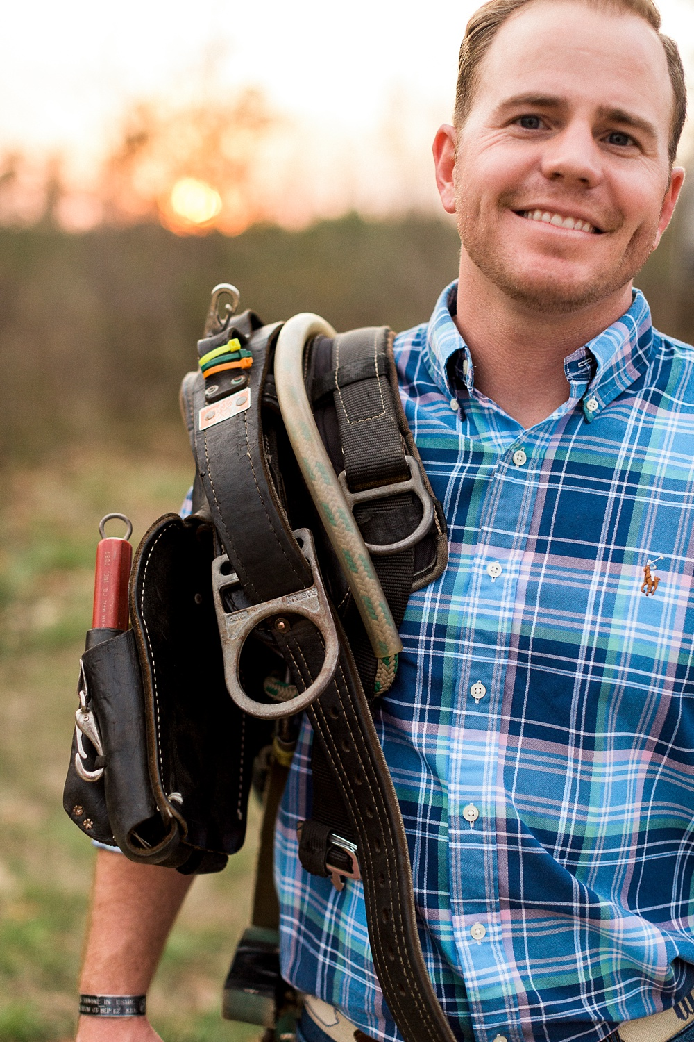 lineman holds his gear over his shoulder
