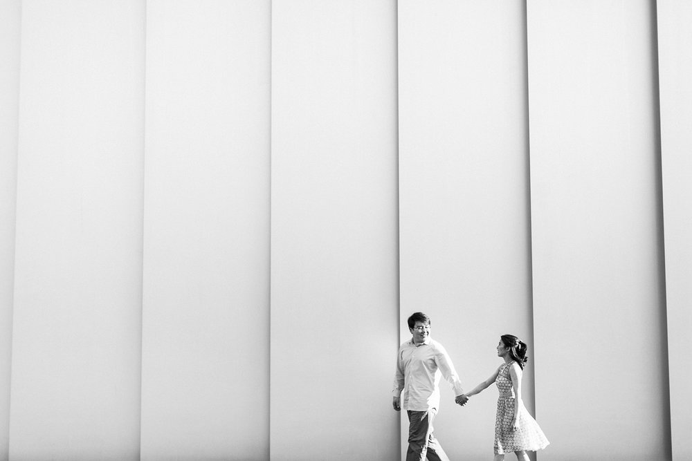 couple strolls in front of the NCMA