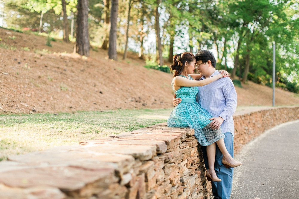 couple sits on a natural stone wall