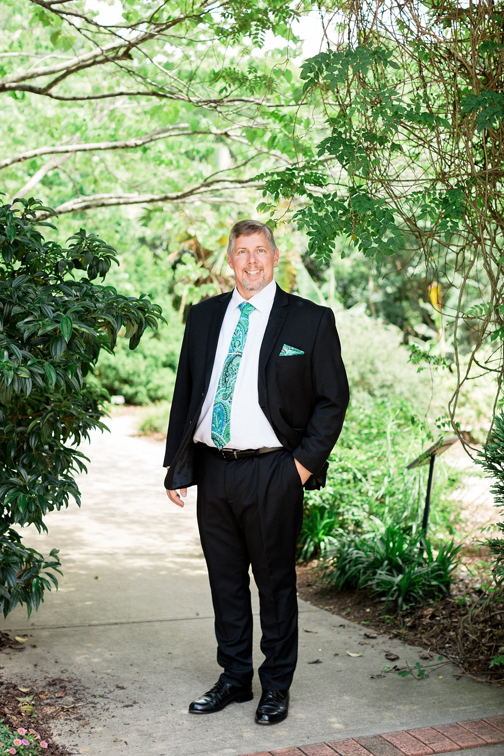 groom poses for a photograph at the raulston arboretum