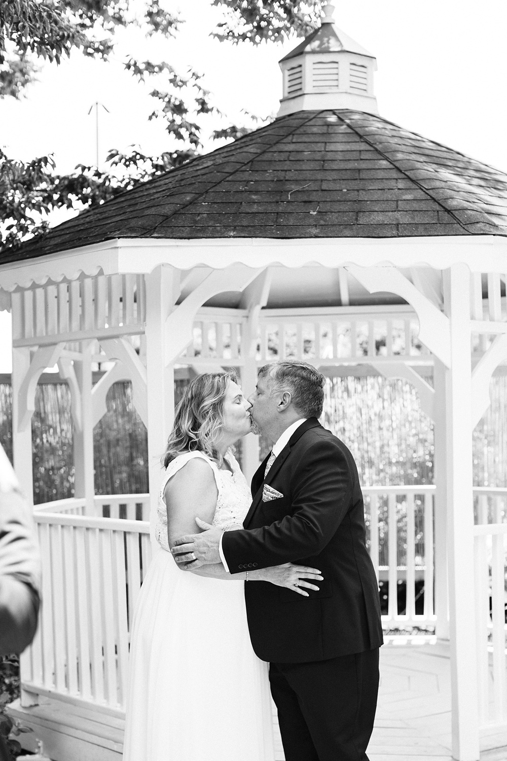 bride and groom kiss at their gazebo ceremony