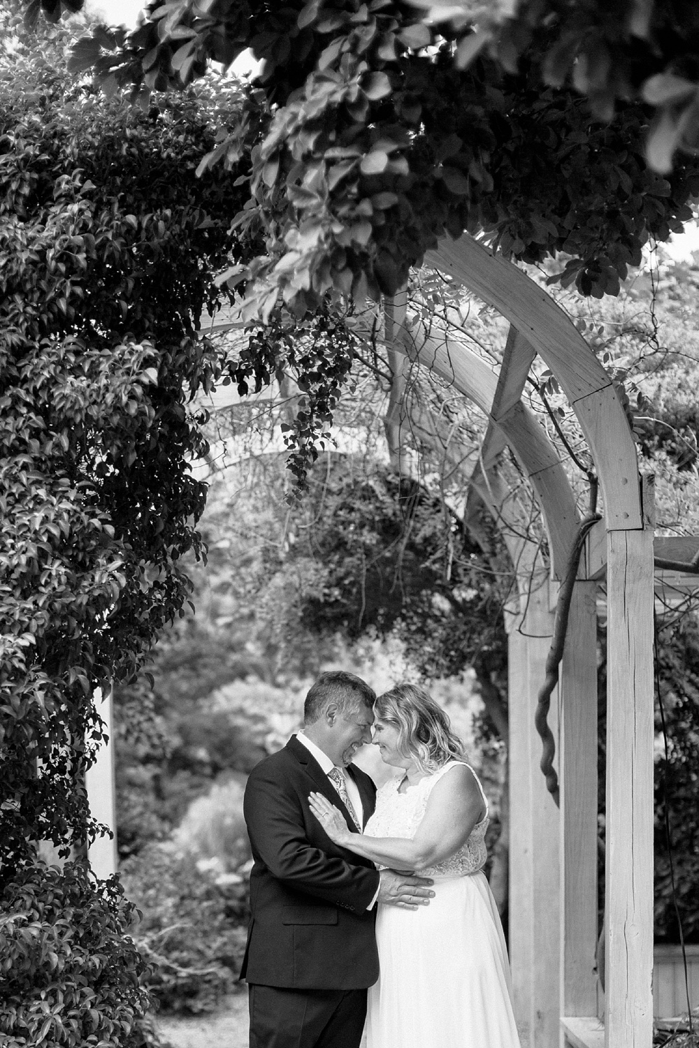 bride and groom touch foreheads and smile