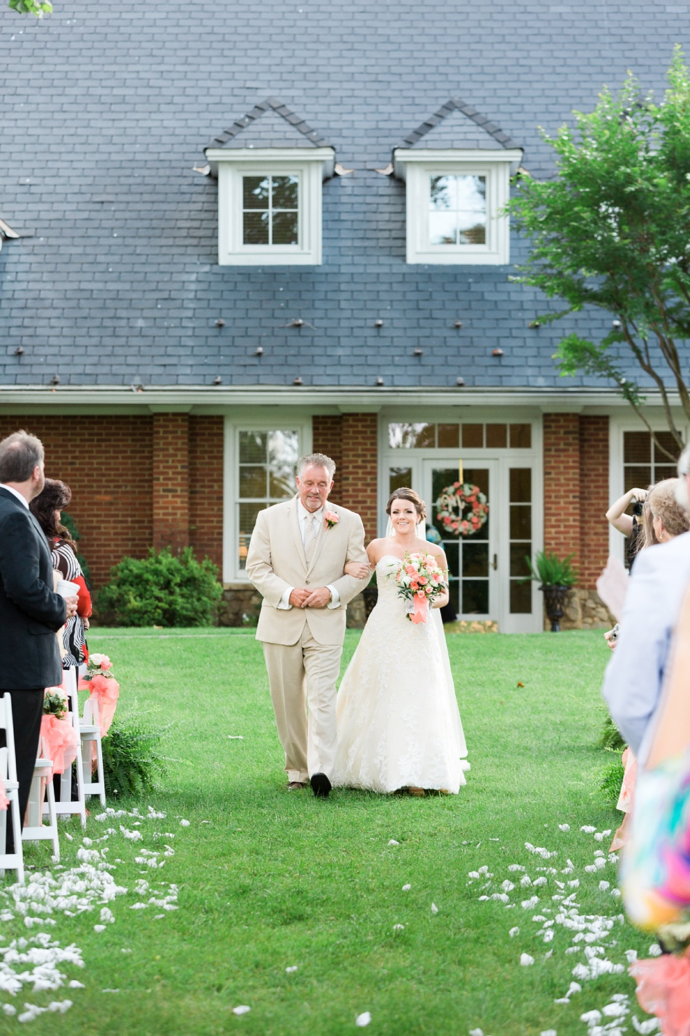 dad and bride walk down the aisle at her chatmoss country club wedding