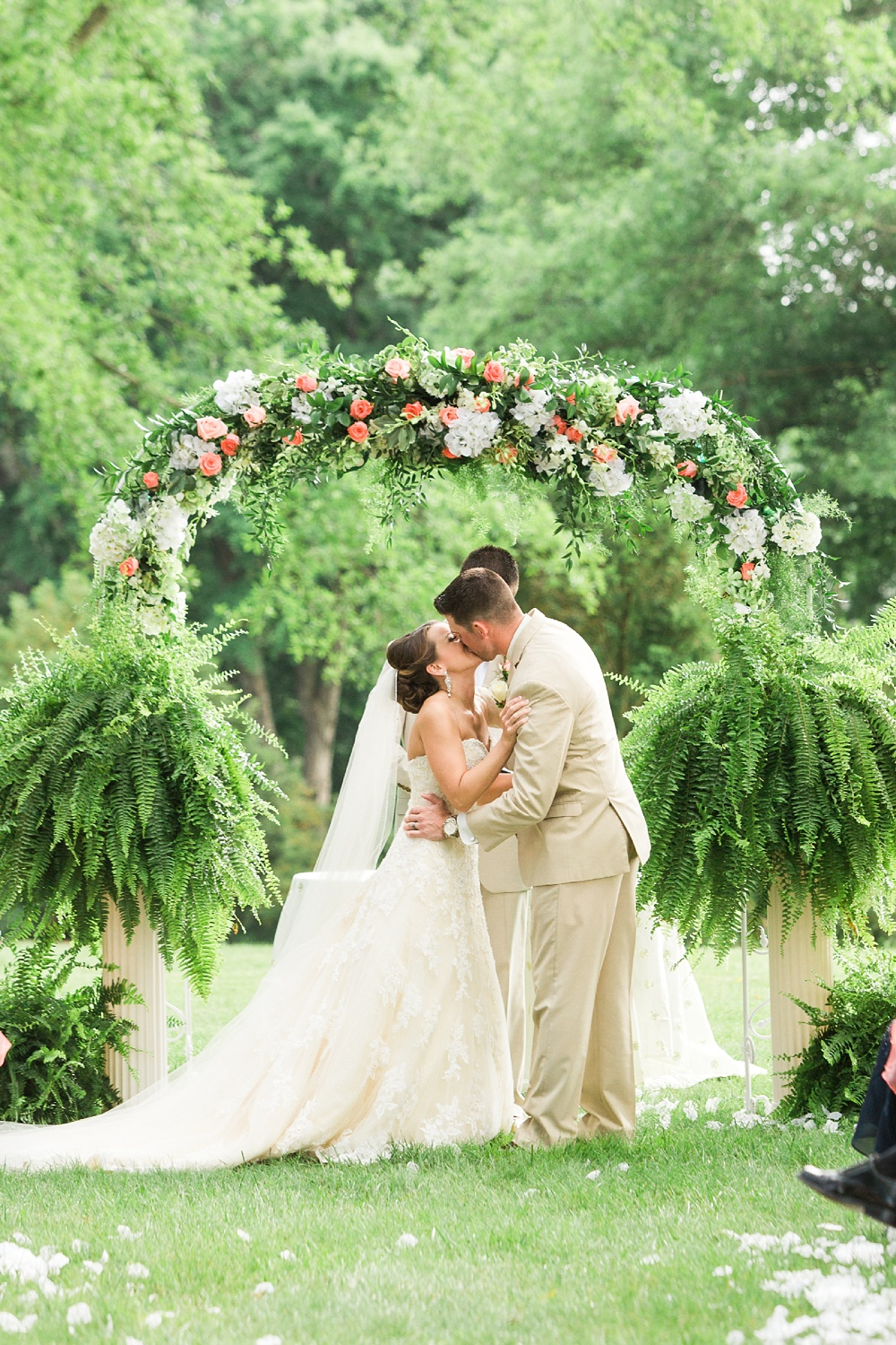bride and groom kiss at their chatmoss country club wedding