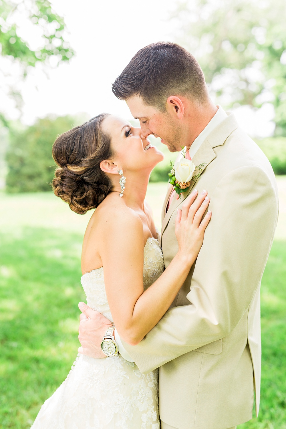 bride and groom kiss at their country club wedding