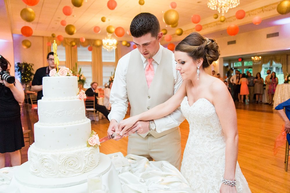 bride and groom cut the cake at their wedding reception