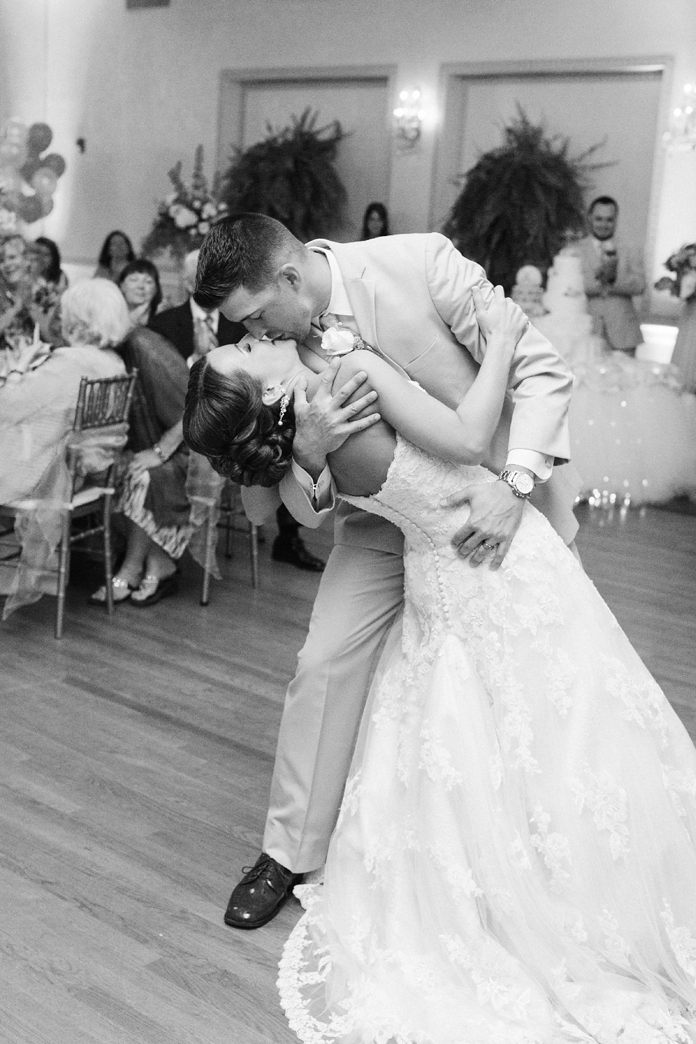bride and groom kiss at the end of their first dance