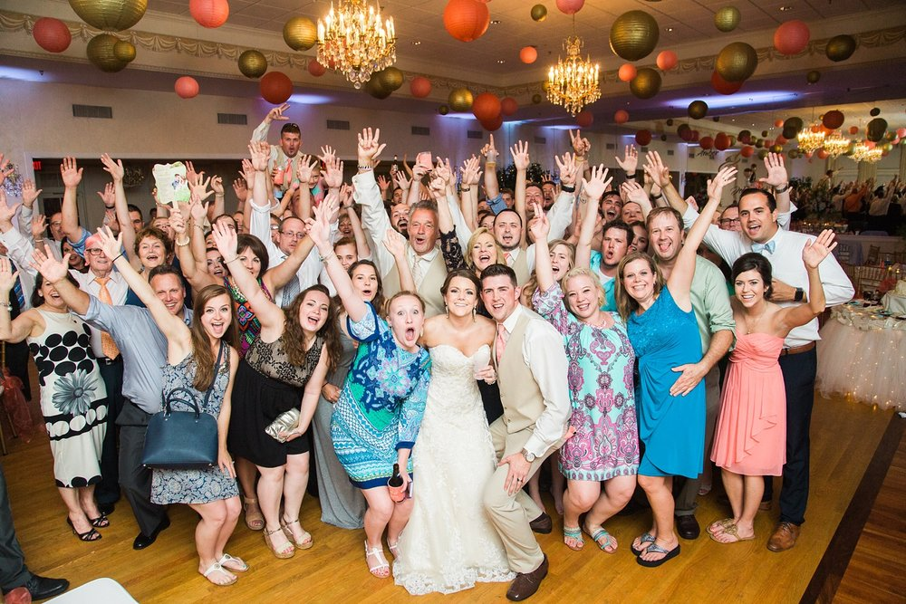 entire wedding reception poses for a photo