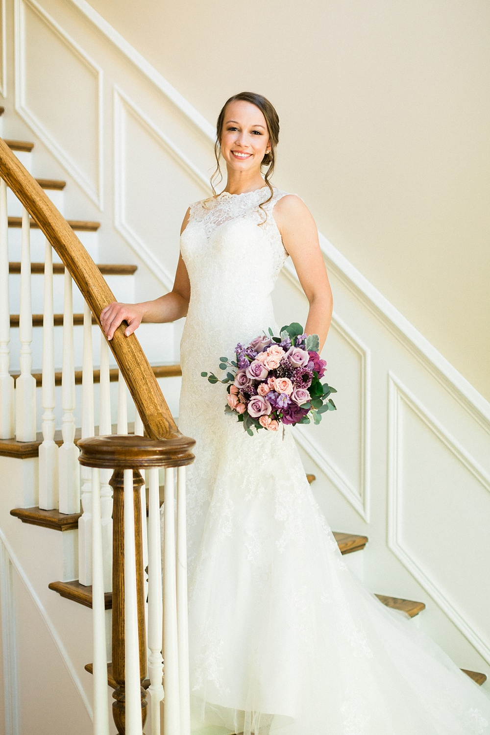 bride poses on a staircase