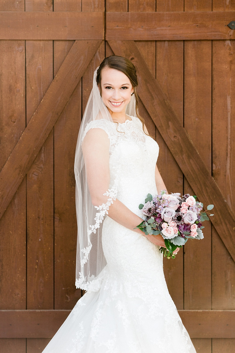 bridal portrait in front of the barn doors at the oaks at salem, apex, nc