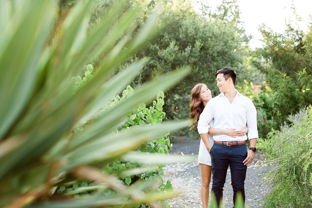 engaged couple in the jc raulston arboretum desert garden