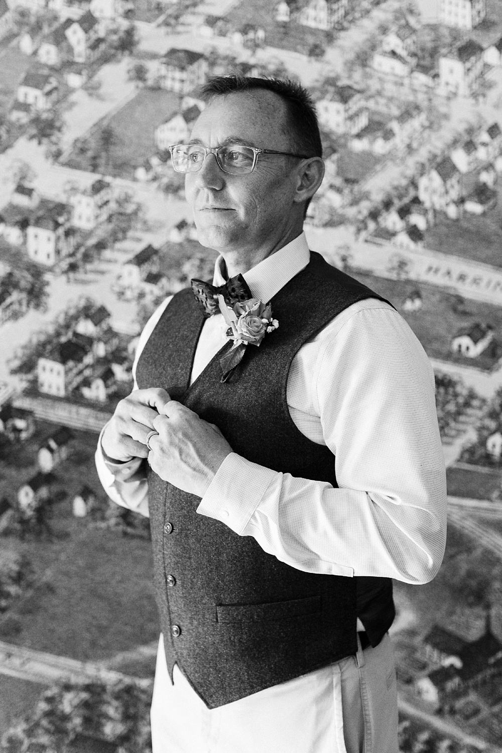 groom portrait in front of the map wall at the city of raleigh museum