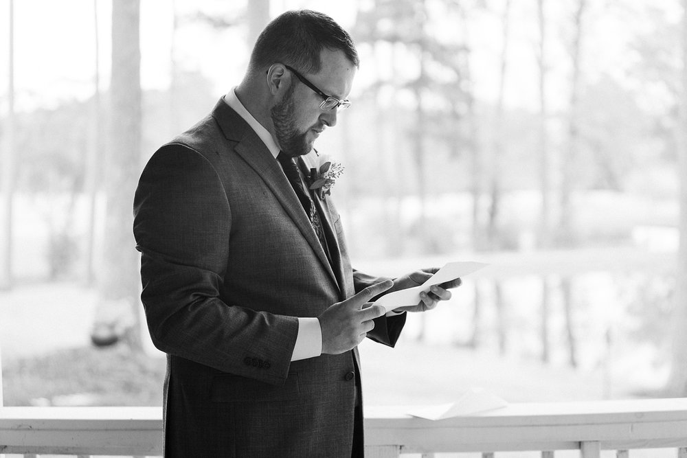groom reads a letter from his bride