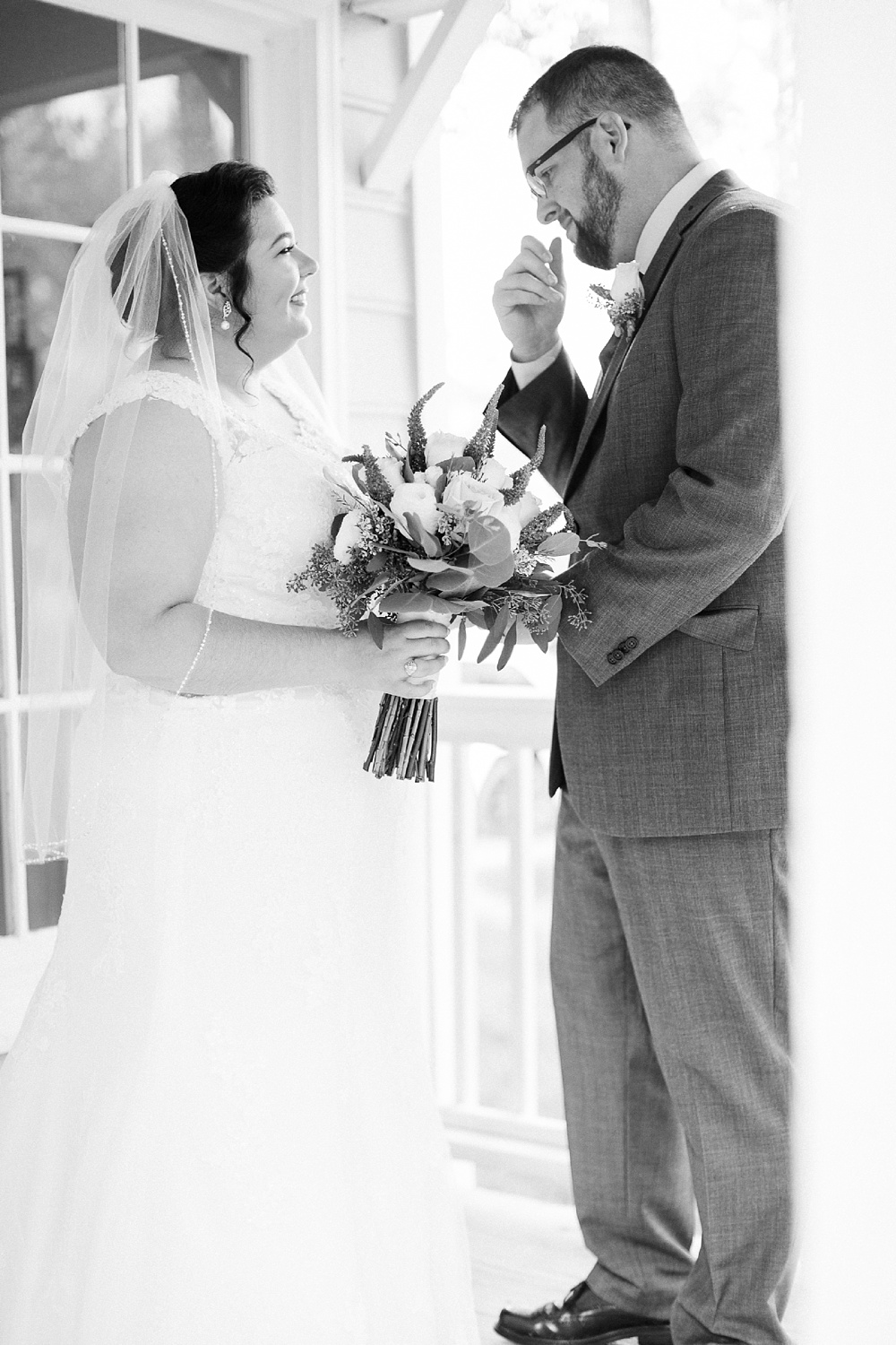 groom sees his bride for the first time at their first look