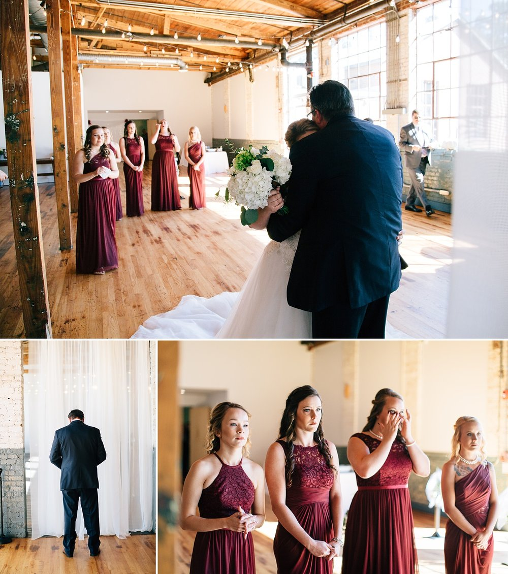 bride has a first look with her dad as the bridesmaids watch