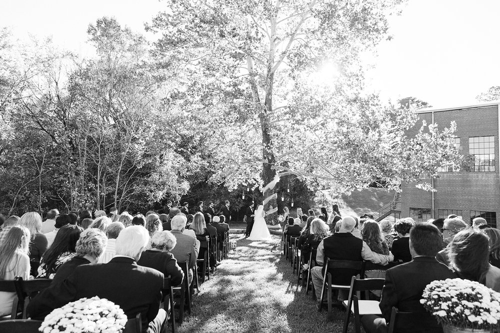 fall outdoor wedding ceremony at forest hall
