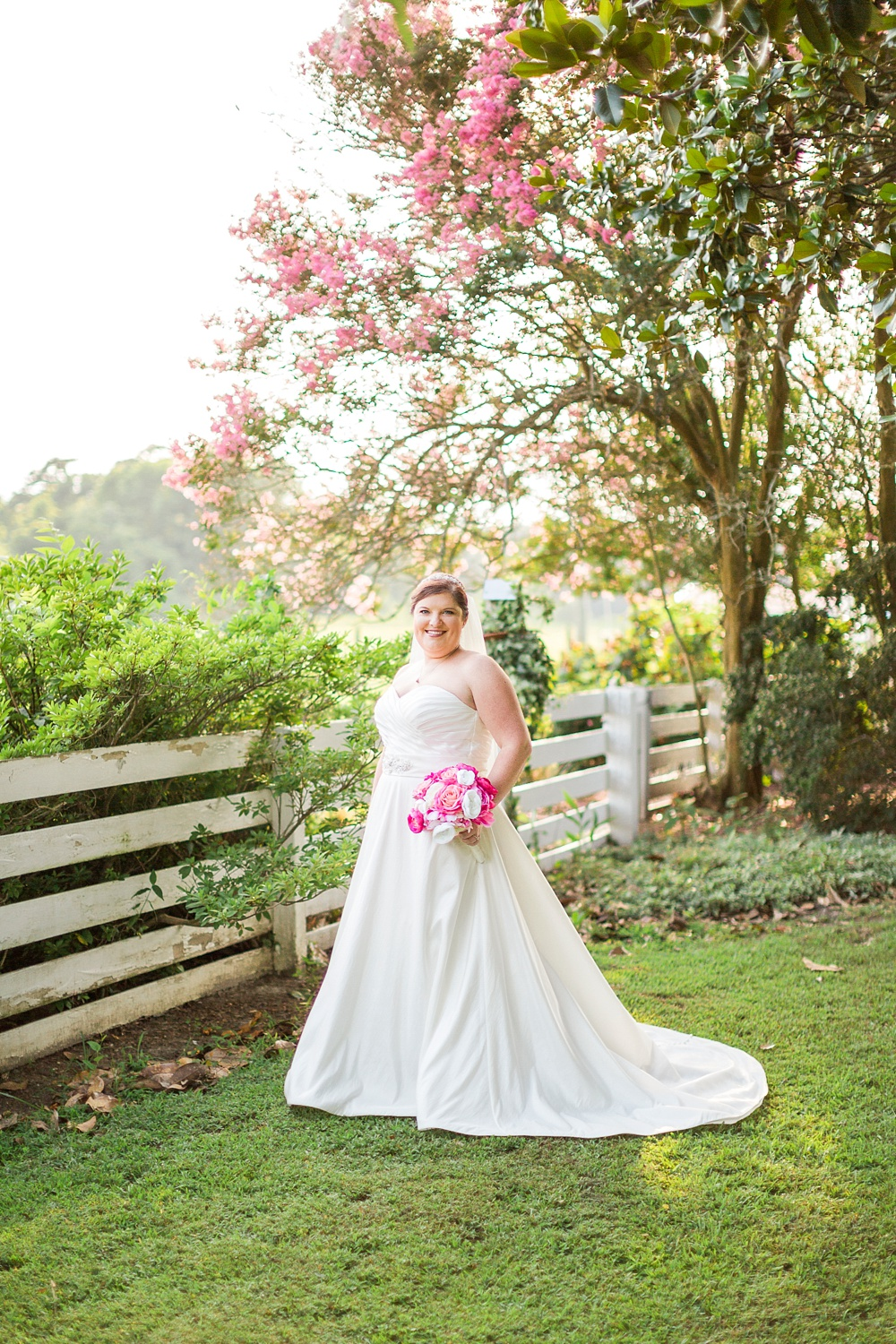bridal portrait under a blooming pink crepe myrtle tree