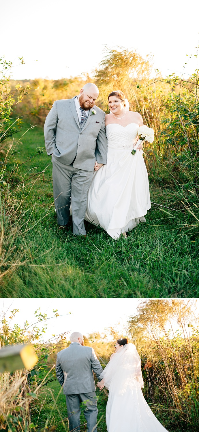 bride and groom walk through the fields at the cotton barn
