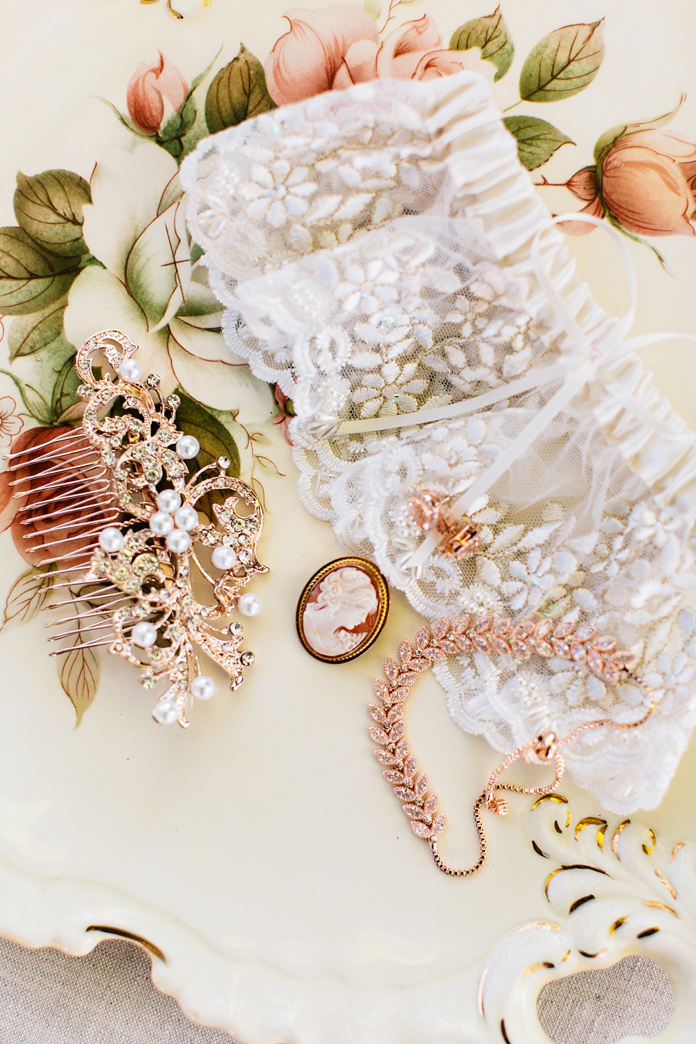 bridal details on an antique tray by rachael bowman photography