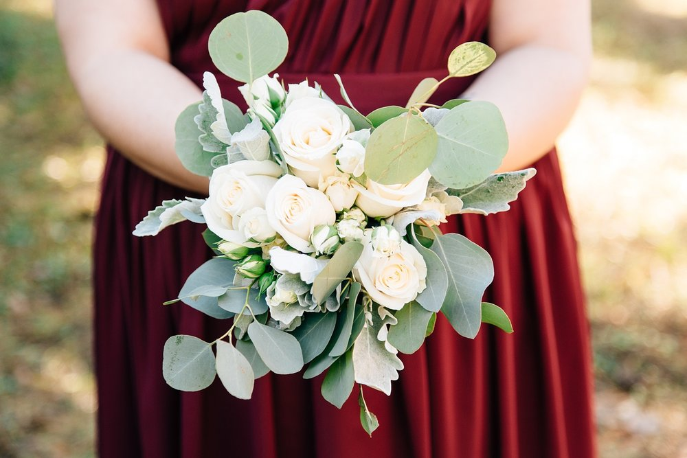 simple white rose and eucalyptus bridesmaid bouquet