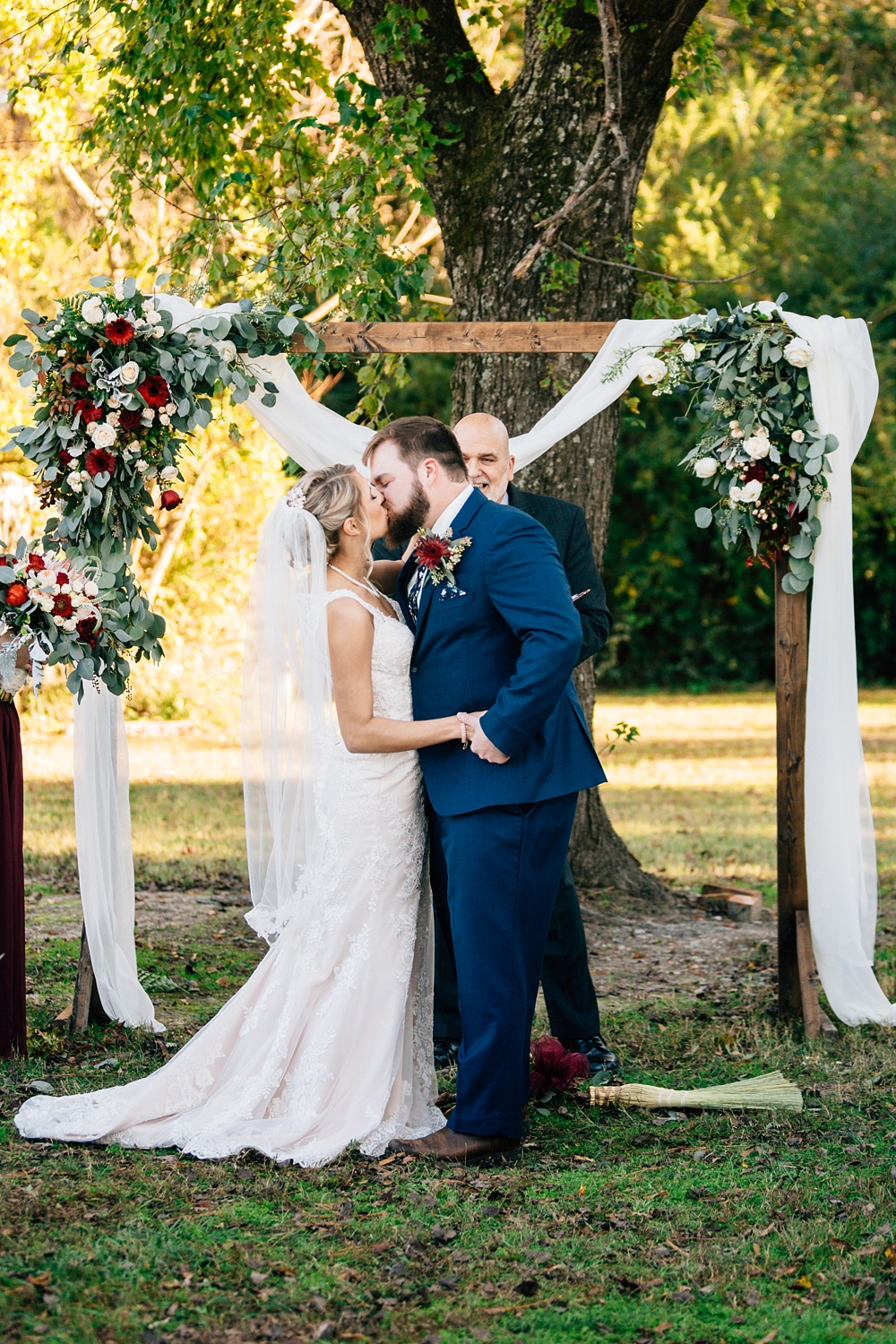 couples shares their first kiss by rachael bowman photography
