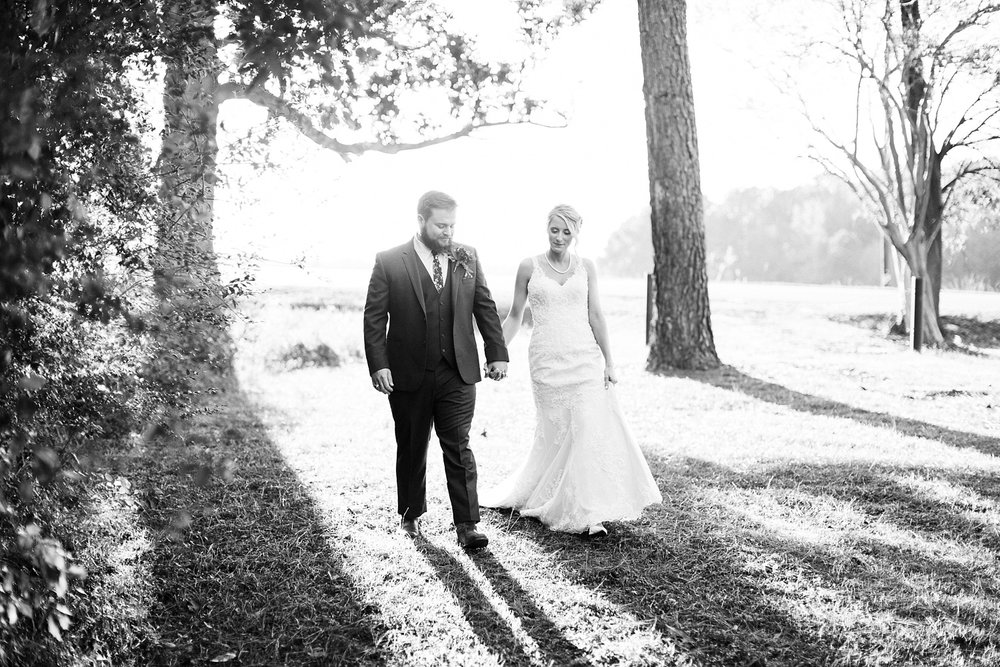 bride and groom walk and hold hands