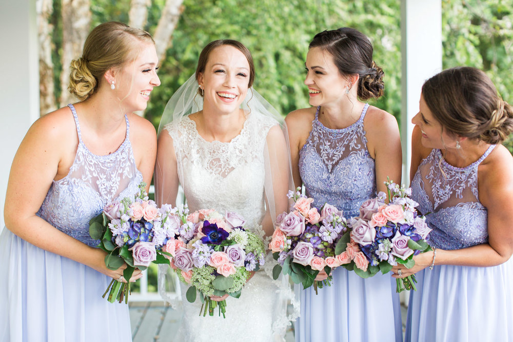 bridal party laughs and smiles
