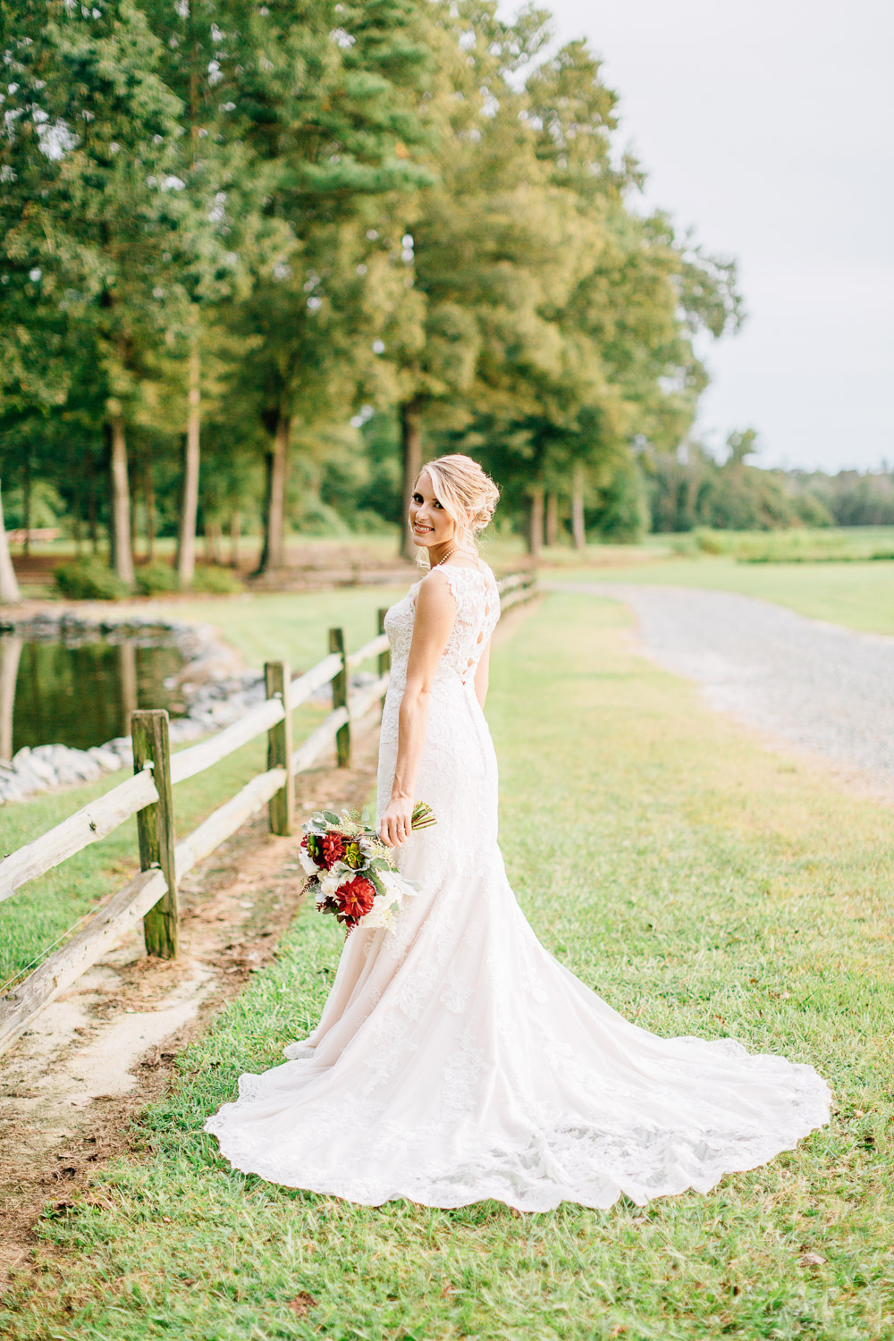 bride looks over her shoulder and smiles
