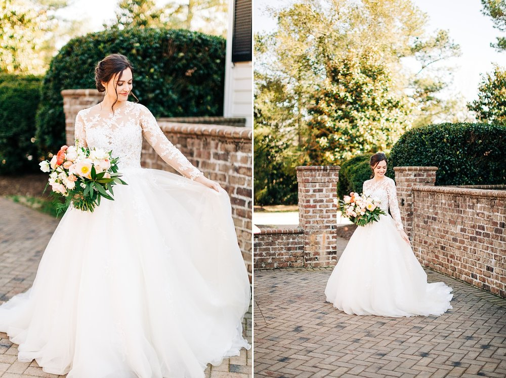 bride twirls in her her romantic lace sleeved dress