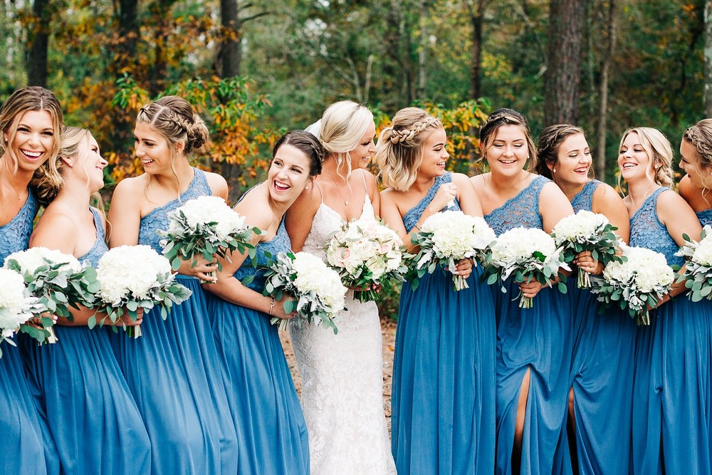 bridesmaids laugh and smile at each other