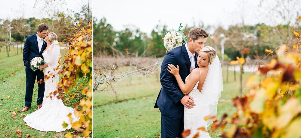 bride and groom kiss in a fall vineyard