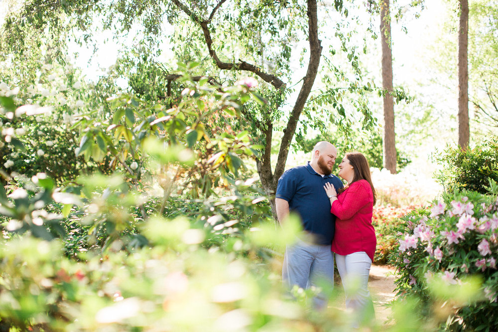 engaged couple in an azalea garden
