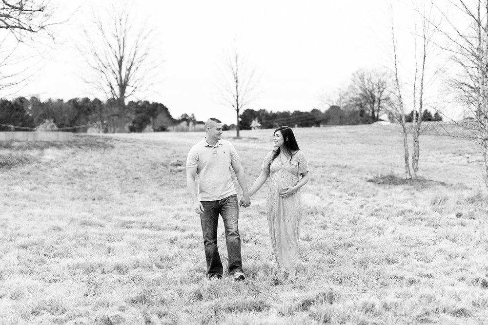 winter maternity session at the north carolina museum of art in raleigh