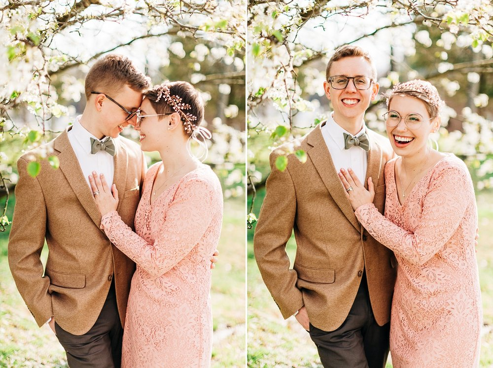 newlyweds under a blooming dogwood tree