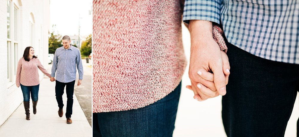 couple walks and holds hands