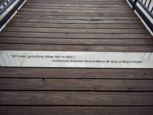 4:52 pm, There were quotes inscribed on the bridge from each of the days leading up to the evacuation and burning of the city. Above, a quote heard just before the barrels of tar placed along the bridge wereset on fire.