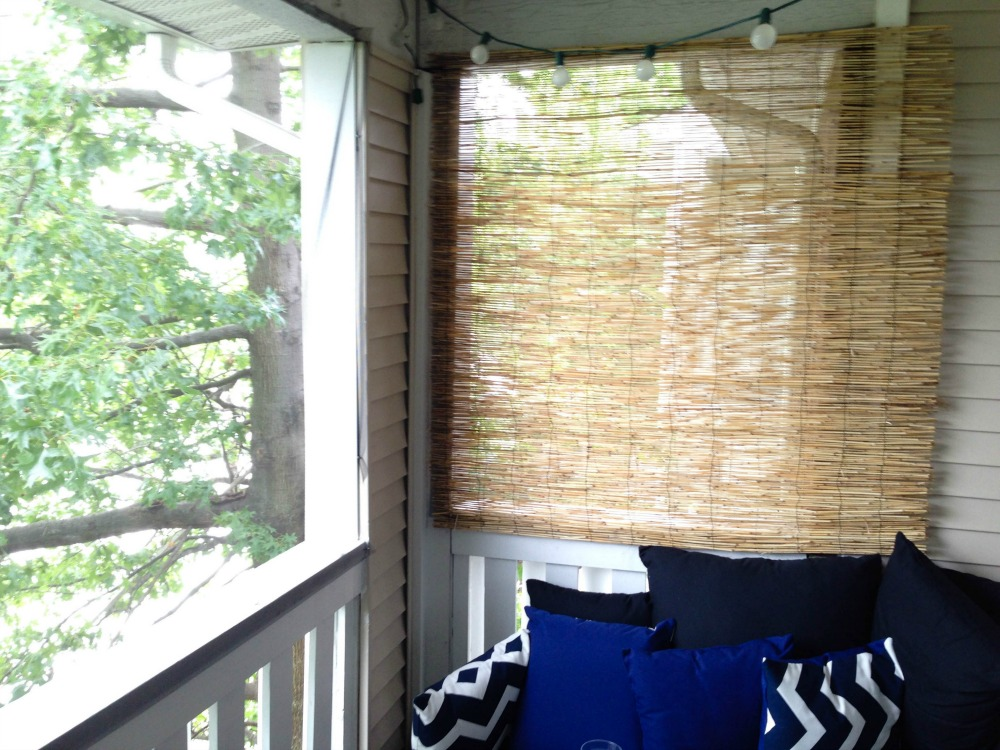 The bamboo was put up to keep neighbors from being able to look directly in on the patio.  And when outdoor pillows became difficult to find (they're out of season; seriously? Cause it's mid-summer), Brittany and the bf took to their DIY skills yet again by hand-sewing pillows using tips found here and here.