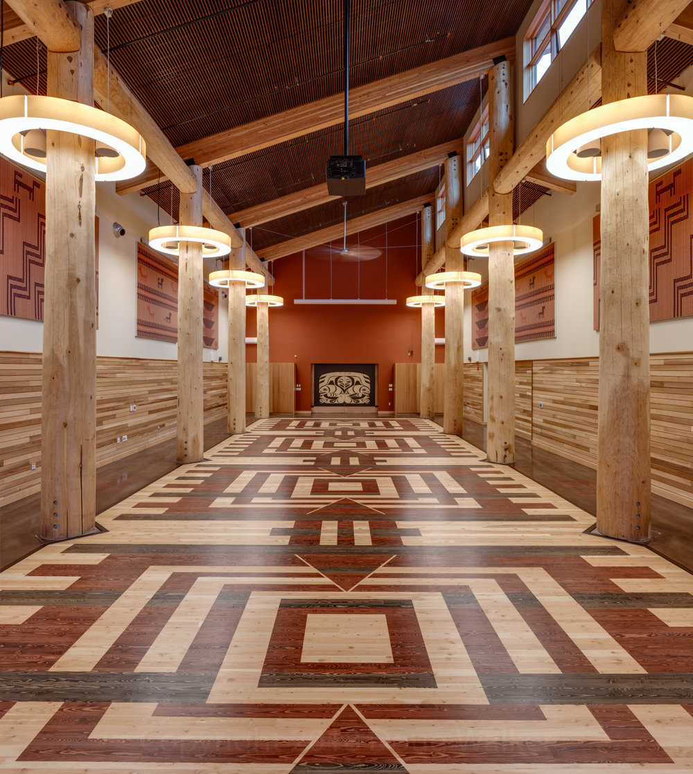 This image of The Skokomish Tribal Community Center's gathering space was featured in  AZURE Magazine's  piece titled  UNCEDED IS CANADA'S EXPLORATION OF INDIGENOUS ARCHITECTURE .  This is a glorious tall space, with cedar wrapped clerestory windows and large circular lamps giving a sense of daylight.