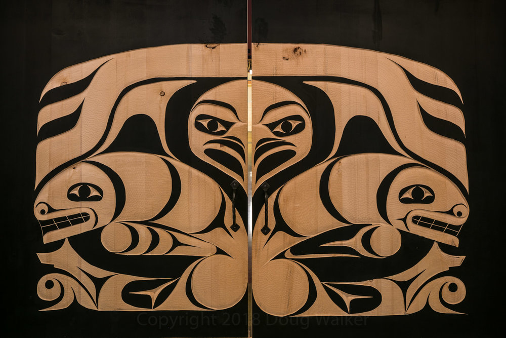 Large carved wood doors feature Skokomish artwork created by Skokomish artists John Edward Smith and Derek Grover. These doors separate the gathering space from the main entry space.