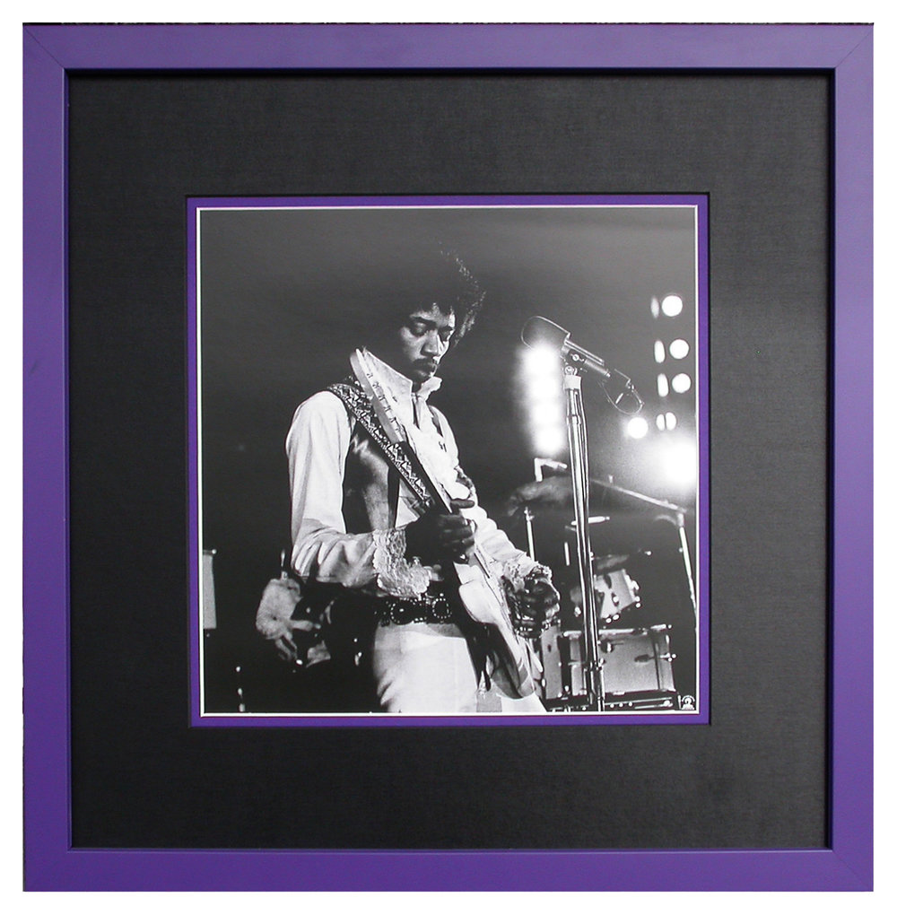 "A black and white photograph of Jimi Hendrix in concert features a black top mat with a purple inner mat and purple frame to suggest (what else) ""Purple Haze""!"