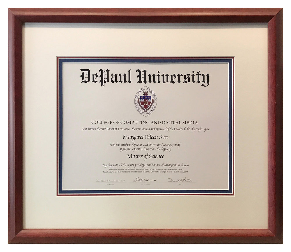 One of many possibilities for framing diplomas.  This example employs a triple mat using a creamy white top mat to coordinate with the document's paper and two inner mats in red and blue...DePaul's school colors.  A mahogany frame completes the design.