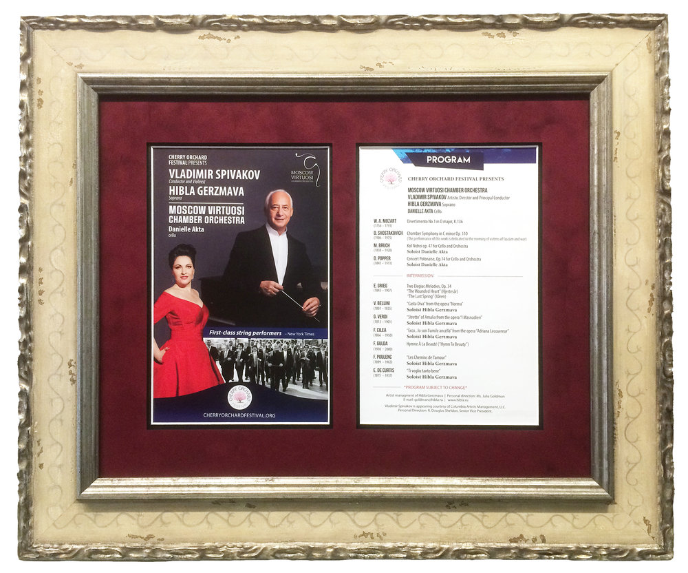 "This concert program for the Moscow Virtuosi Chamber Orchestra was framed in a Larson-Juhl ""Bolshoi"" frame with a burgundy suede mat.  Museum glass was utilized to protect  the program from UV light and minimize reflections."